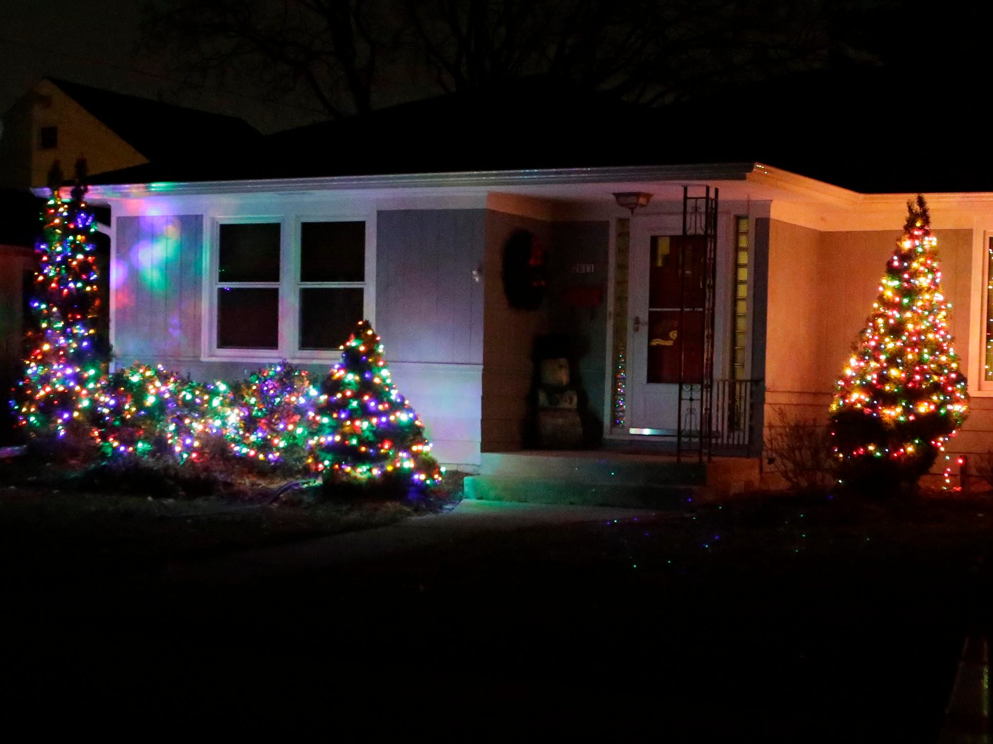 Bushes and trees glow with light, Thursday, December 13, 2018, in Sheboygan, Wis.