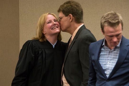 Mike Hanson kisses his wife, Sandra Hoglund Hanson, after her swearing in ceremony at the Minnehaha County Clerk-Courts in Sioux Falls, S.D., Friday, Dec. 14, 2018.