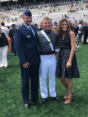 Luke Meyers poses with his parents, Mike and Betsy Meyers. Meyers graduated from West Point and is an officer in the U.S. Army.