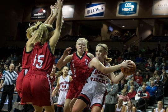Brandon Valley's Danica Kocer (32) looks to pass the ball during a game against Yankton at the Sanford Pentagon in Sioux Falls, S.D., Thursday, Dec. 13, 2018.