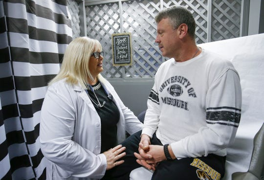 Dr. Tricia Derges meets with patient Robert Beckett at the Lift Up Springfield medical clinic on Friday, Dec. 14, 2018. Derges was named the 2018 Humanitarian Award recipient for her work with Lift Up Springfield.