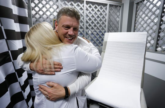 Dr. Tricia Derges hugs patient Robert Beckett at the Lift Up Springfield medical clinic on Friday, Dec. 14, 2018. Derges was named the 2018 Humanitarian Award recipient for her work with Lift Up Springfield.
