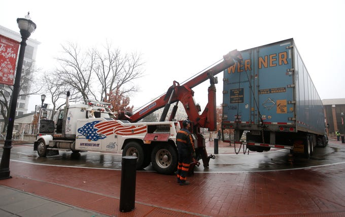 A tractor-trailer became stuck on pylons that encircle the Park Central Square as it tried to navigate the road this afternoon, despite the signs leading up to the square that indicating no trucks allowed.