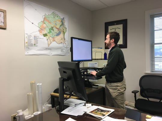 Waynesboro city planner, Luke Juday, works in his office. As he looks to Waynesboro's future development, capitalizing on the city's natural beauty will be key, he said.