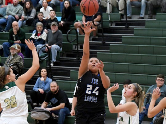 Alayia Robinson hit two late free throws to help Robert E. Lee's girls basketball team hold off Buffalo Gap on Friday.