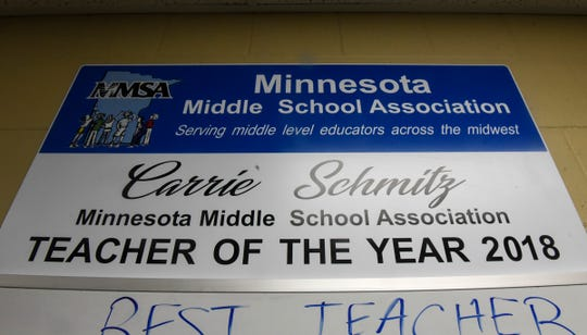 A sign outlines Carrie'Schmitz's award in her classroom in Albany.