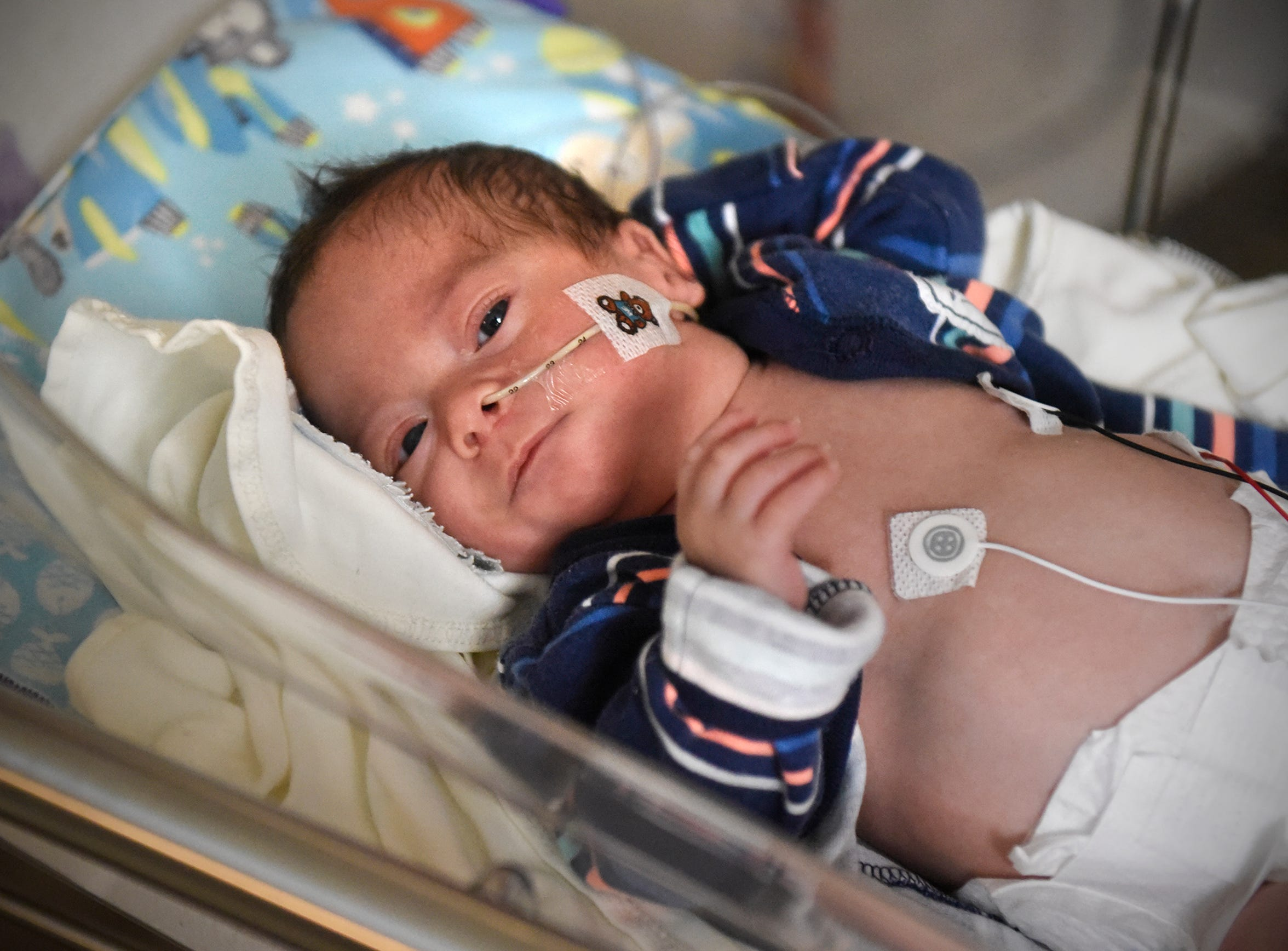 Joshua Johnson wakes up from a nap Wednesday, Dec. 12, at the St. Cloud Hospital's Neonatal Intensive Care Unit.