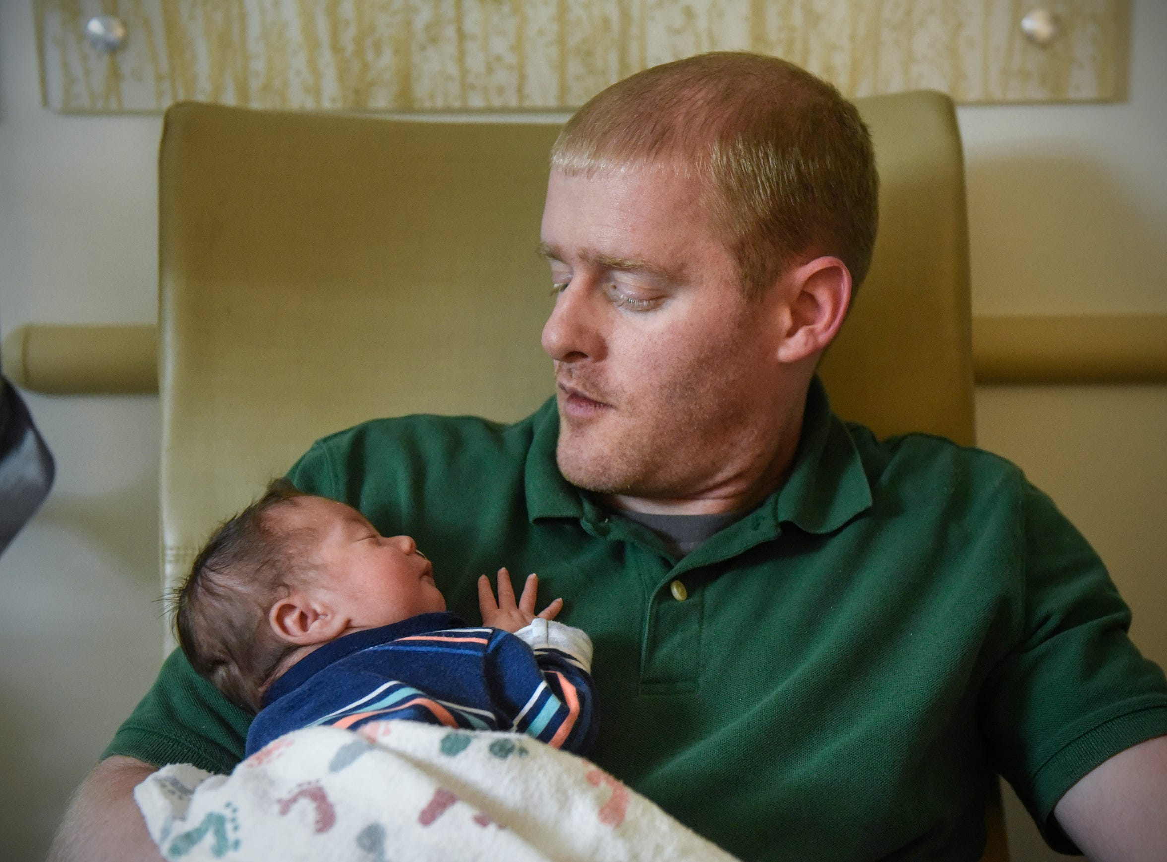 Christopher Johnson holds his son, Joshua, Wednesday, Dec. 12, at the St. Cloud Hospital's Neonatal Intensive Care Unit.