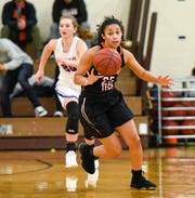 St. Cloud Tech's Meya Washington breaks away with the ball against St. Cloud Apollo  during the first half Thursday, Dec. 13, at Tech High School.