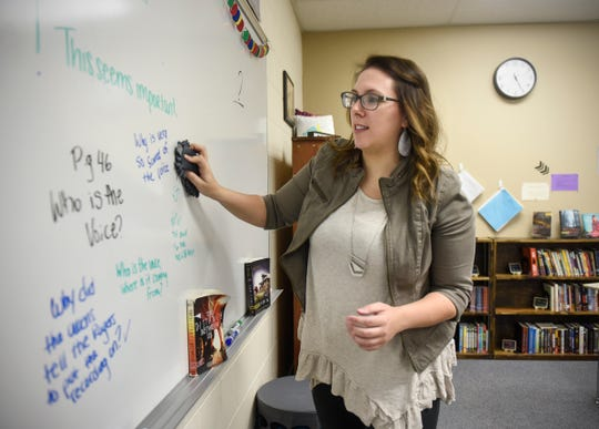 Carrie Schmitz prepares for an incoming group of students in her classroom Thursday, Dec. 13, in Albany.