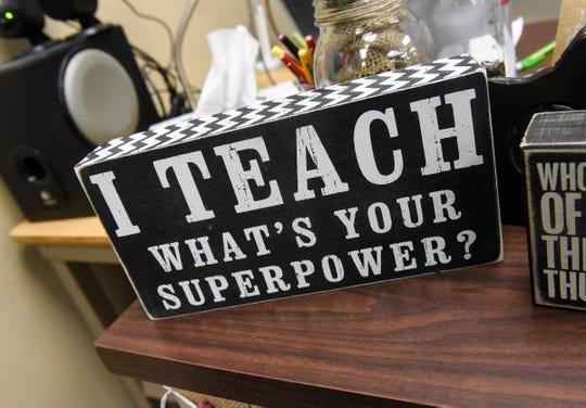 An item displayed on the desk of teacher Carrie Schmitz.