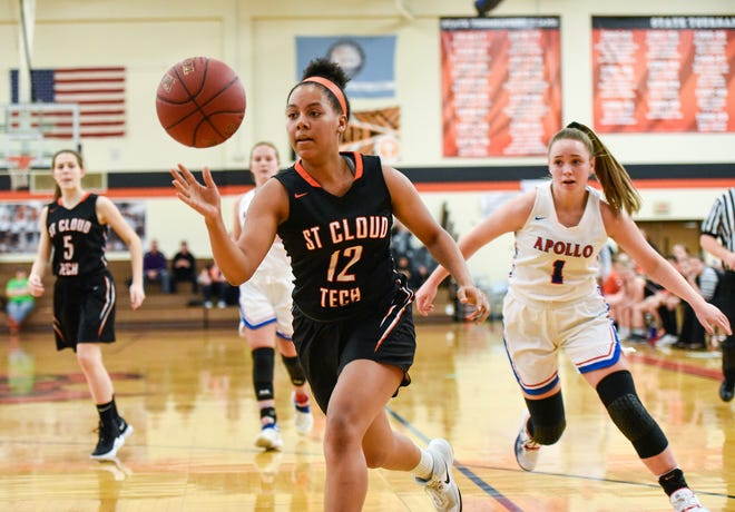 St. Cloud Tech's Genaya Murray goes in to the basket against St. Cloud Apollo during the first half Thursday, Dec. 13, at Tech High School.