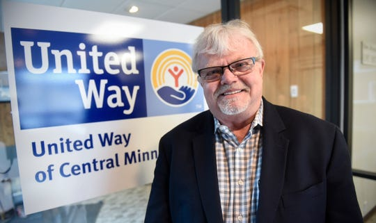 New United Way of Central Minnesota President and CEO Larry Olness  poses for a photograph Thursday, Dec. 13, in St. Cloud.