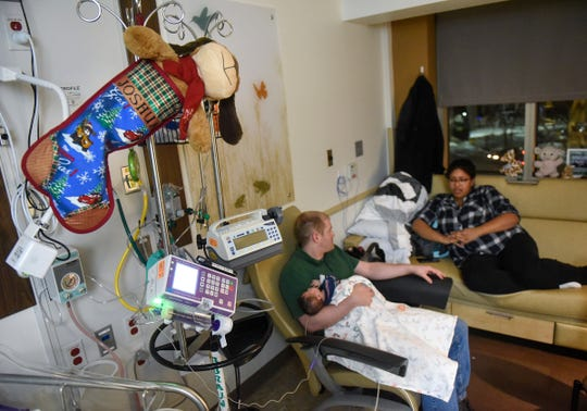 Vicki and Christopher Johnson talk about their son, Joshua, Wednesday, Dec. 12, at the St. Cloud Hospital's Neonatal Intensive Care Unit.