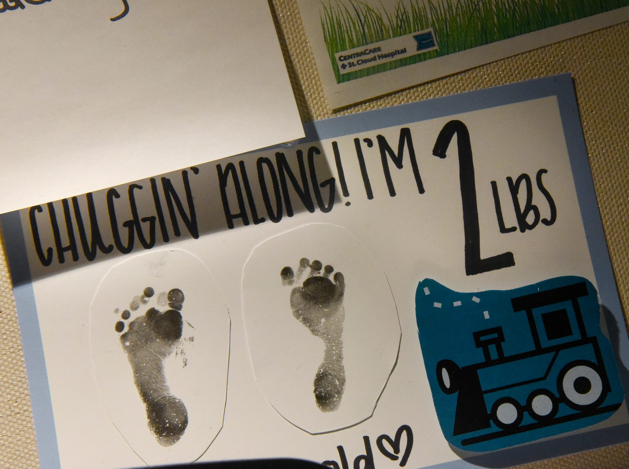 Signs marking the progress of Joshua Johnson hang on the wall of his room Wednesday, Dec. 12, at the St. Cloud Hospital's Neonatal Intensive Care Unit.