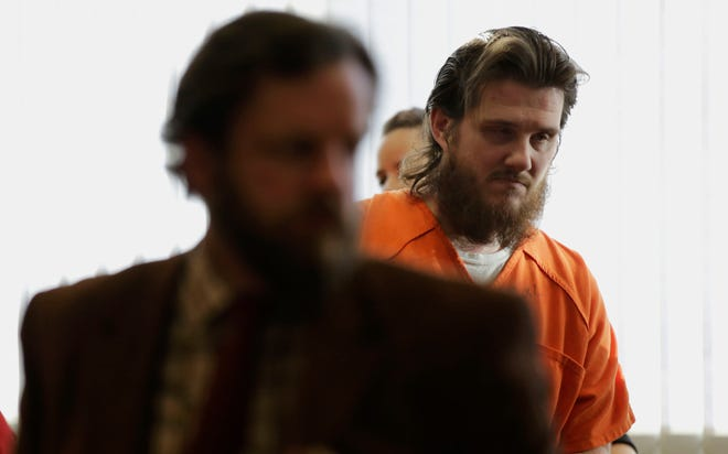 James Georgeson is escorted from the courtroom following his sentencing hearing on Friday, December 14, 2018, at the Wood County courthouse in Wisconsin Rapids, Wis. Georgeson was convicted of second-degree reckless homicide for the death of his infant son, and was sentenced to 15 years confinement with an additional 10 years of extended supervision.Tork Mason/USA TODAY NETWORK-Wisconsin