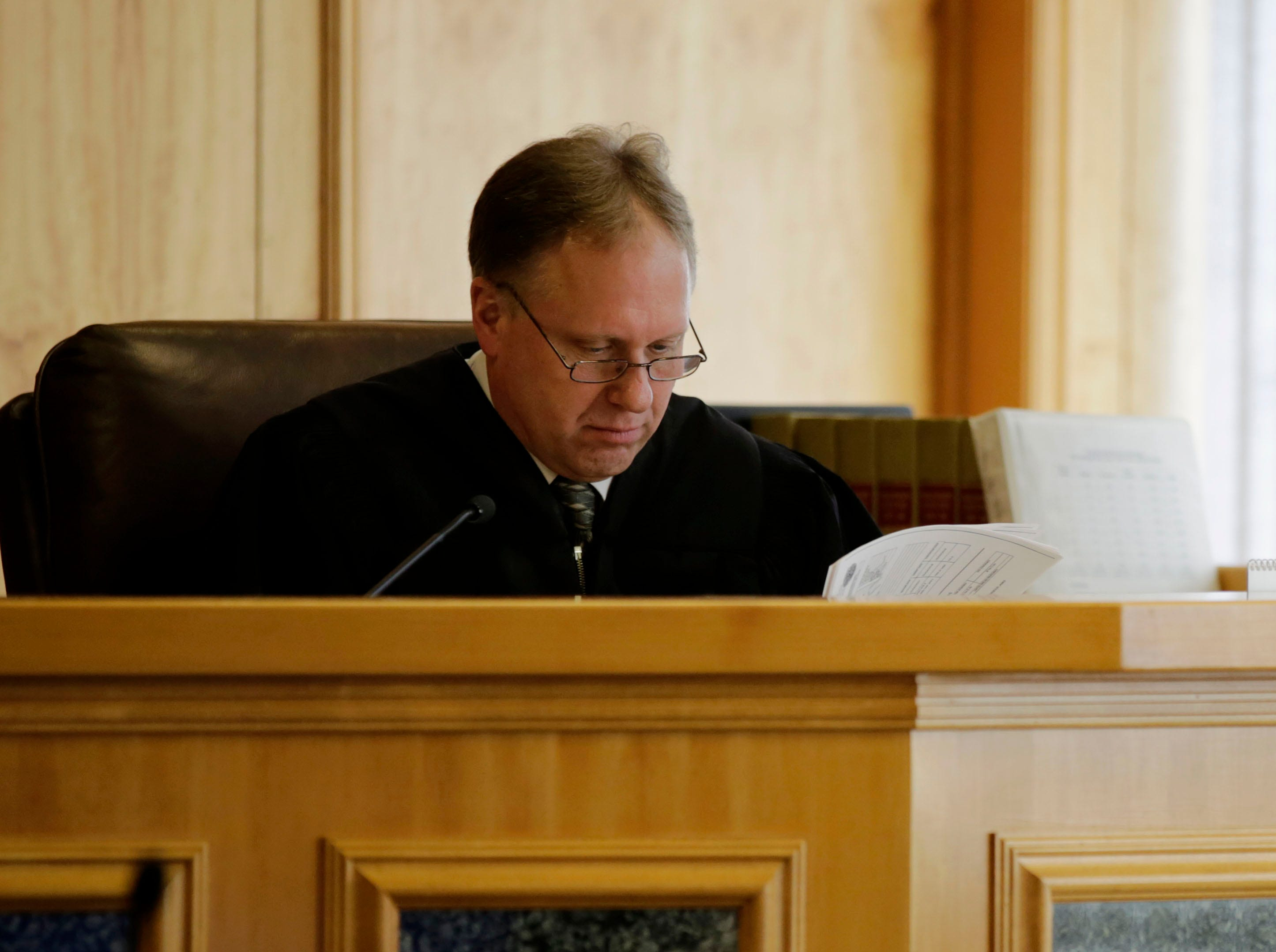 Circuit Court Judge Todd Wolf reviews his notes while listening to testimony during a sentencing hearing for James Georgeson on Friday, December 14, 2018, at the Wood County courthouse in Wisconsin Rapids, Wis.Tork Mason/USA TODAY NETWORK-Wisconsin