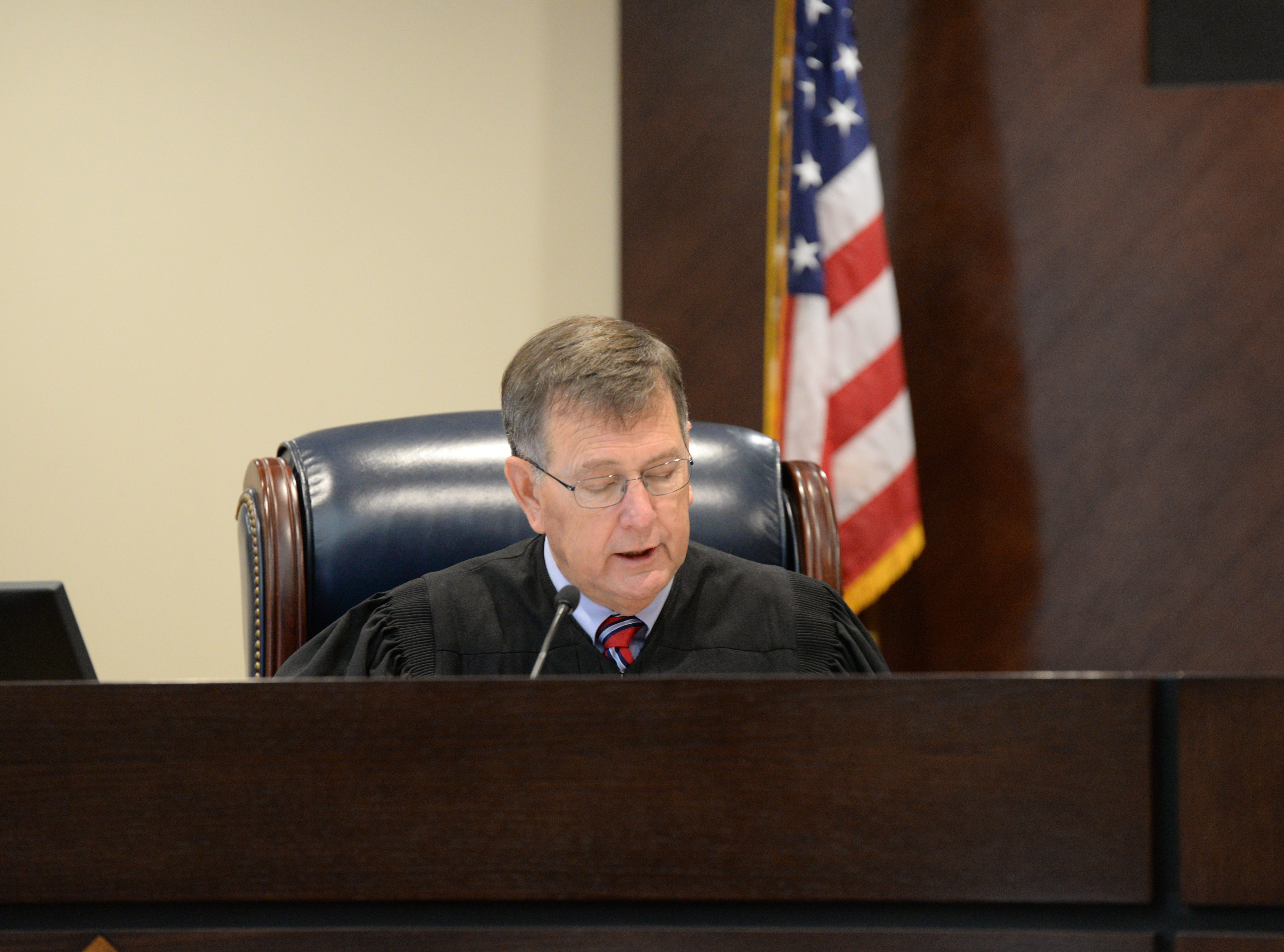 Circuit Judge James Hankinson reads jury instructions during the trial of Denise Williams for the murder of her husband Mike Williams at the Leon County Courthouse Friday, Dec. 14, 2018.