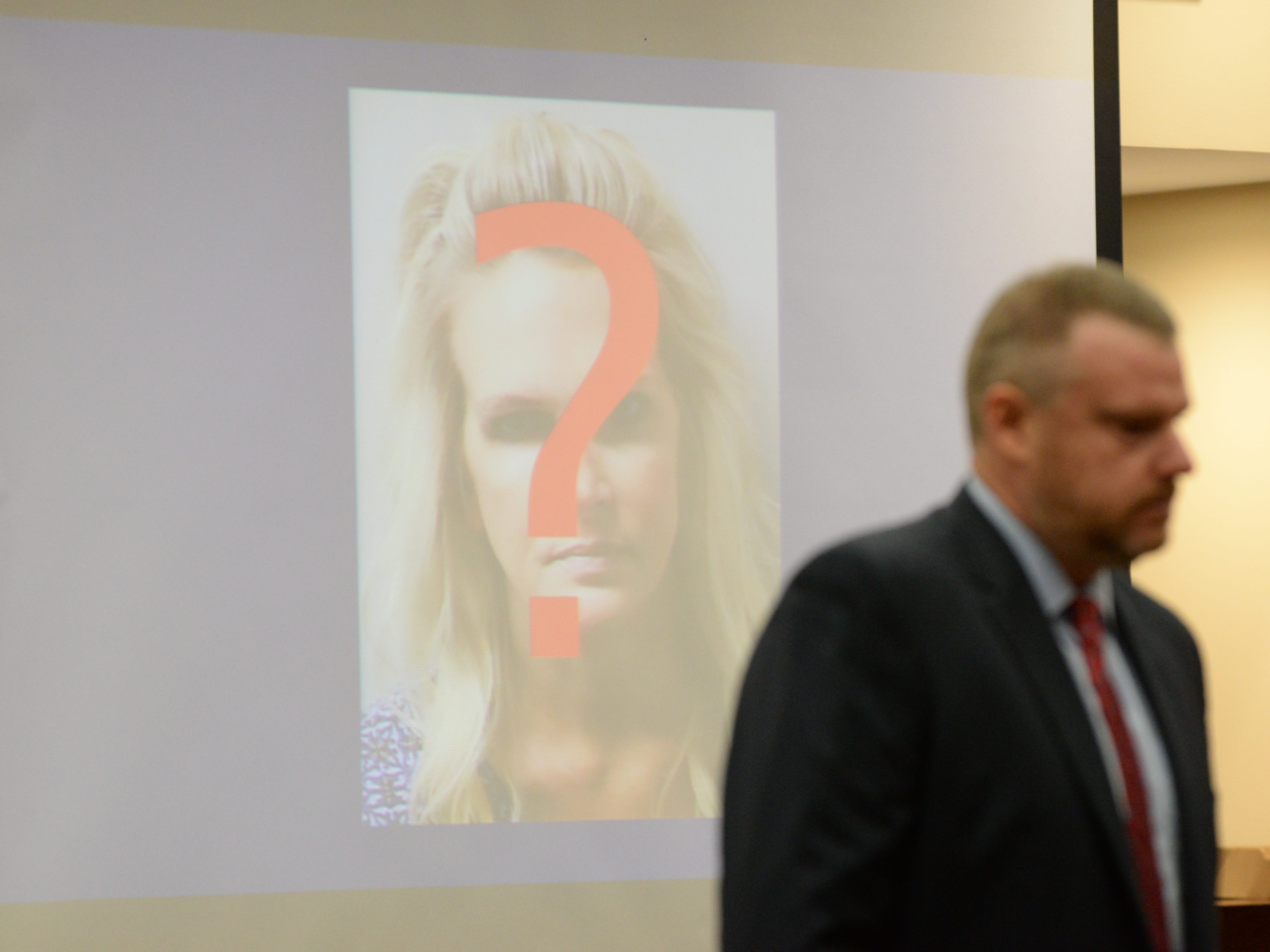 Assistant State Attorney Jon Fuchs displays the mugshot of Denise Williams during his closing arguments in the trial of Denise Williams for the murder of her husband Mike Williams at the Leon County Courthouse Friday, Dec. 14, 2018.