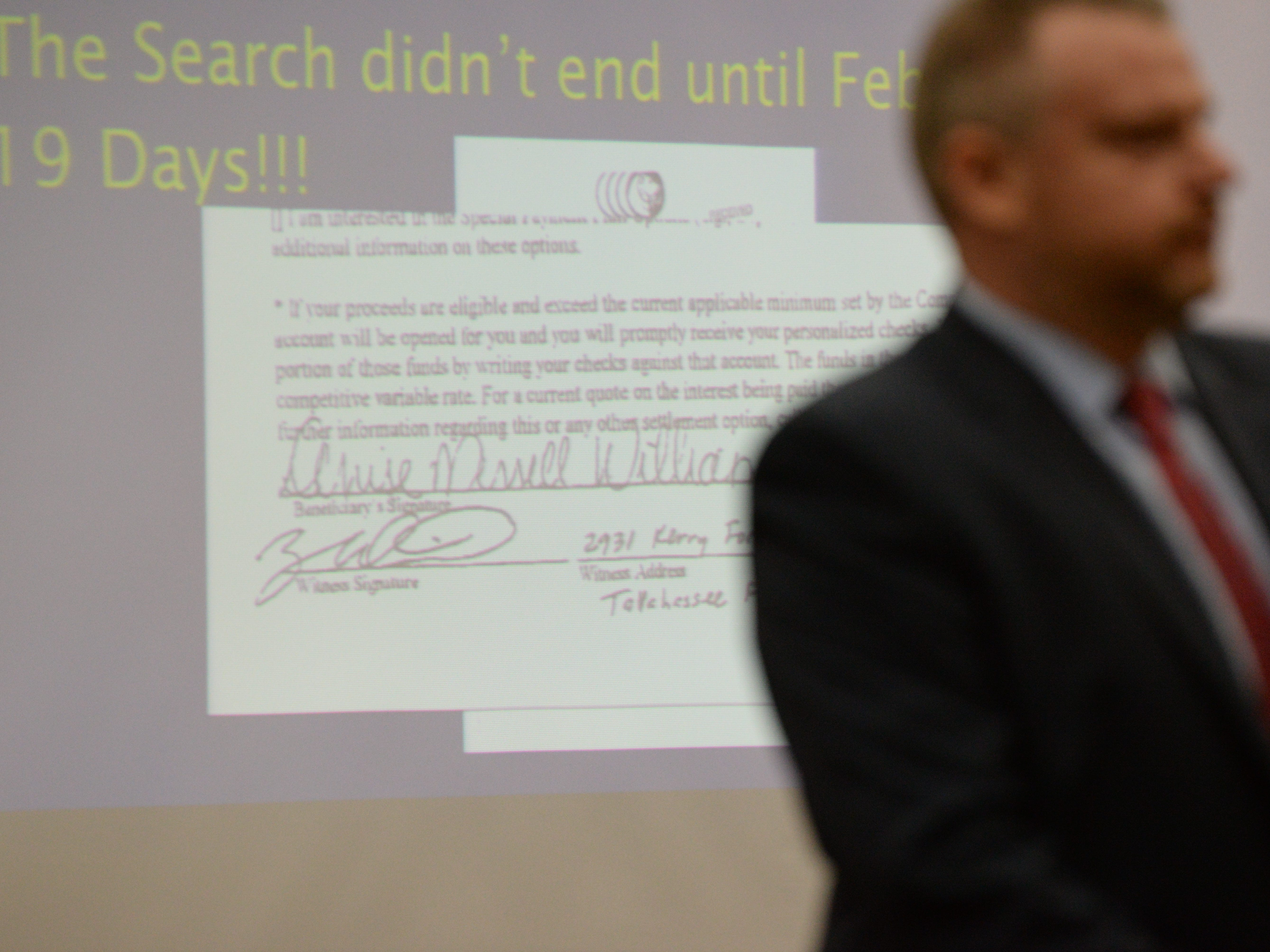 Assistant State Attorney Jon Fuchs shows the signature of Denise Williams on the life insurance policy of Mike Williams during the trial of Denise Williams for the murder of her husband Mike Williams at the Leon County Courthouse Friday, Dec. 14, 2018.