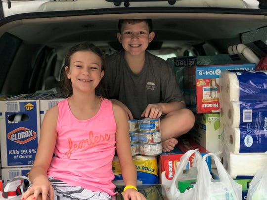 Amanda and Tony Laudadio's two youngest kids pose for a photo before handing out donations to storm-impacted areas.