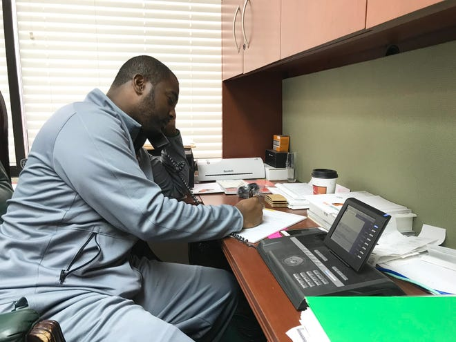 FAMU football coach Willie Simmons discusses recruiting strategies with his assistants over the phone.