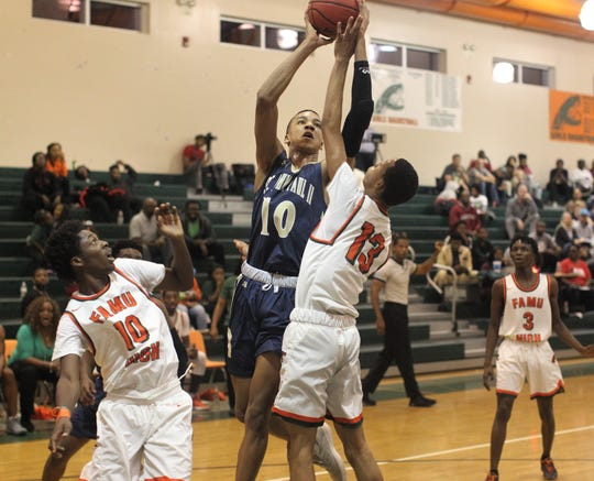 St. John Paul II senior Allan Jeanne-Rose goes up for a basket as the Panthers beat FAMU DRS on Dec. 4, 2018.