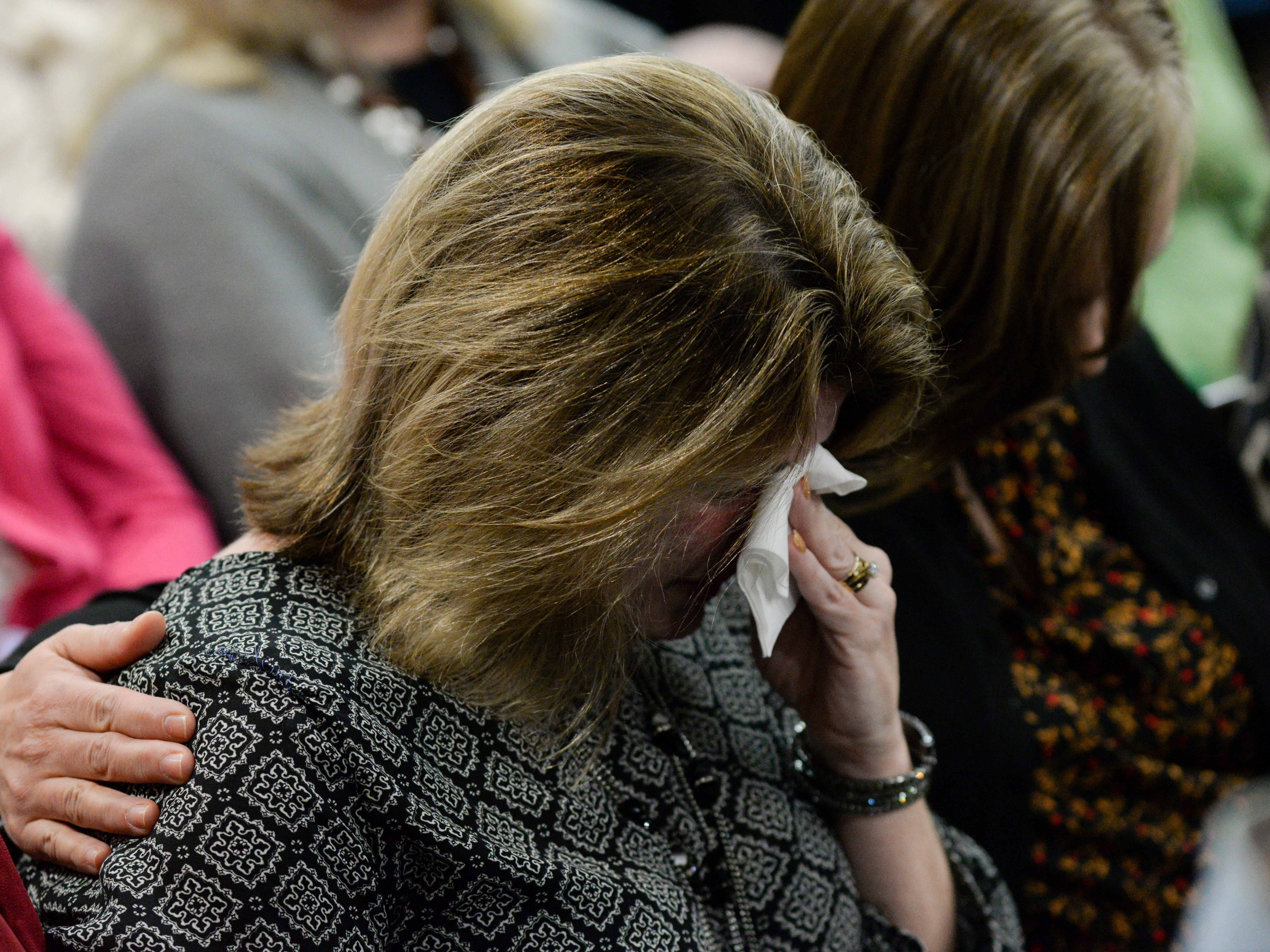 Kathy Thomas comforts Lindsay Lockhart as she cries as Assistant State Attorney Jon Fuchs finishes his rebuttal in closing arguments during the trial of Denise Williams for the murder of her husband Mike Williams at the Leon County Courthouse Friday, Dec. 14, 2018.