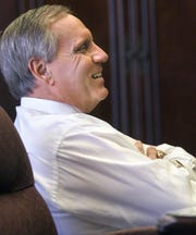 Florida State University President T.K. Wetherell laughs during an interview in his office on his first day as FSU's new president in January 2003.