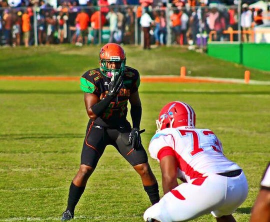 Former FAMU star Akil Blount reads the formation against Delaware State at Bragg Memorial Stadium.