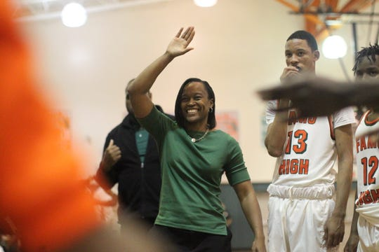FAMU DRS boys basketball coach Dione Desir readies for a high five during player introductions prior to a game against St. John Paul II on Dec. 4, 2018.