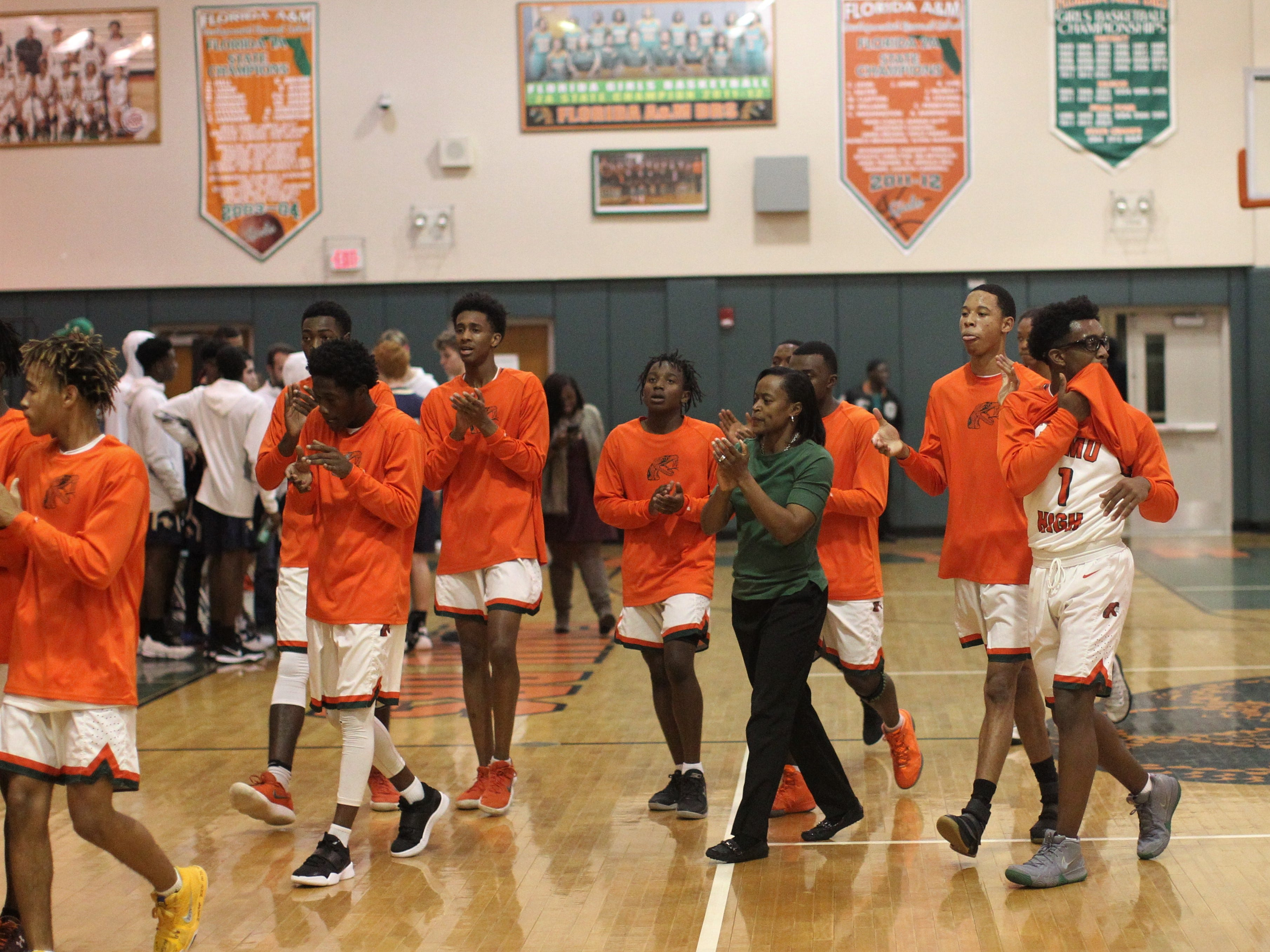 FAMU DRS boys basketball coach Dione Desir and her Rattlers team prepare for a game against St. John Paul II on Dec. 4, 2018.