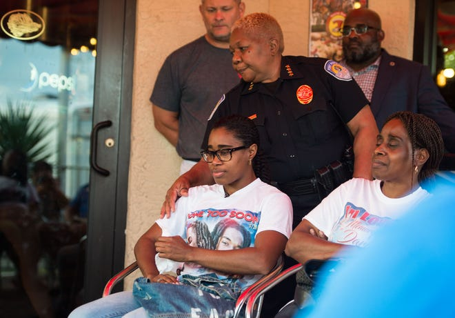 "Lisan Douglas — whose brother, Darien Douglas, 21, was killed in the fatal crash Nov. 23, 2018, that claimed four other lives — is comforted by Fort Pierce Chief of Police Diane Hobley-Burney after talking about her brother during a gathering of victims' relatives at Big Apple Pizza on Friday, Dec. 14, in Fort Pierce. ""I was proud to be his sister,"" Lisan Douglas said. ""Even now, it's been hard…I look in the mirror and I see my brother, because I know we look so much alike."" Their mother, Beverly Douglas, sits at right. St. Lucie County Sheriff Ken Mascara, Fire District Chief Nate Spera and Fort Pierce Mayor Linda Hudson also attended the meeting, coordinated by restaurant owner Scott Van Duzer, who is holding a fundraiser for the families at 4 p.m. on Wednesday."