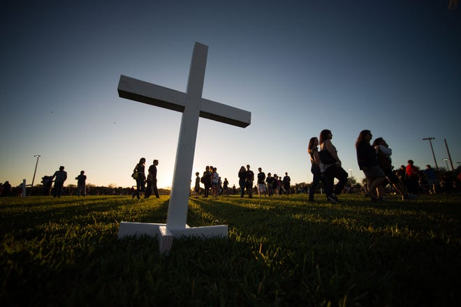 A candlelight vigil drew thousands to the Pine Trails Park amphitheater Thursday, Feb. 15, 2018, to mourn a day after the mass shooting at Marjory Stoneman Douglas High School in Parkland.