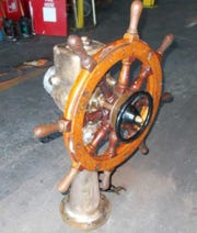 The ship's wheel from the Voici Bernadette is one of the items the St. Lucie County Reef Builders hope to sell.