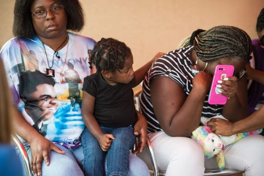 Two-year-old Shavaya Martin (center) —whose brother, Anthony Martin, 16, was one of five fatalities in a crash Nov. 23, 2018, in St. Lucie County — comforts her mother, Shynell Wilson (right), as Anthony's aunt, Shirley McCormick, speaks during a meeting of victims' relatives at Big Apple Pizza on Friday, Dec. 14, in Fort Pierce. St. Lucie County Sheriff Ken Mascara, Fire District Chief Nate Spera, Fort Pierce Mayor Linda Hudson and Chief of Police Diane Hobley-Burney also attended the meeting, coordinated by restaurant owner Scott Van Duzer, who is holding a fundraiser for the families at 4 p.m. on Wednesday.