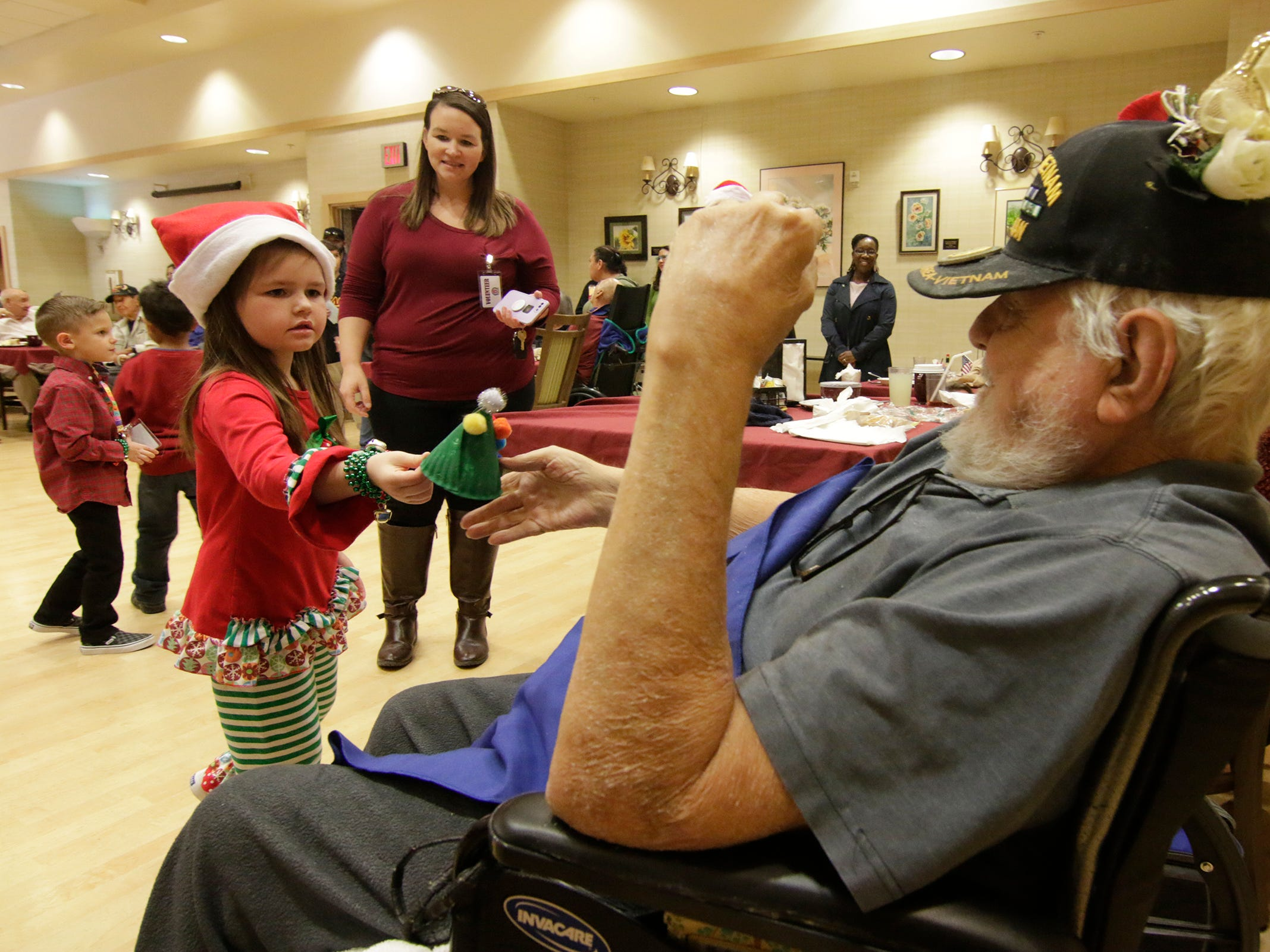 Students from Sgt. Jose F. Carrasco Elementary from SISD, spent their lunch time singing to seniors. The kindergarten students visited three separate dining areas at the Ambrosio Guillen Texas State Veterans Home in northeast El Paso. The students also presented the residents of the home handmade Christmas ornaments.
