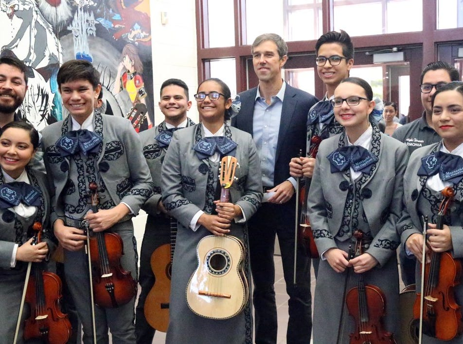 U.S. Rep. Beto O'Rourke, D-El Paso, poses for a photo with members of a mariachi group Friday at Chapin High School. The group performed before his town hall.