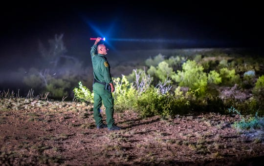 In this June 24, 2015, file photo, a Border Patrol agent looks for other agents in the Animas mountains in New Mexico's boot heel. A 7-year-old Guatemalan girl, picked up with her father and dozens of other migrants along the remote stretch of the U.S.-Mexico border, has died, federal officials said Friday.