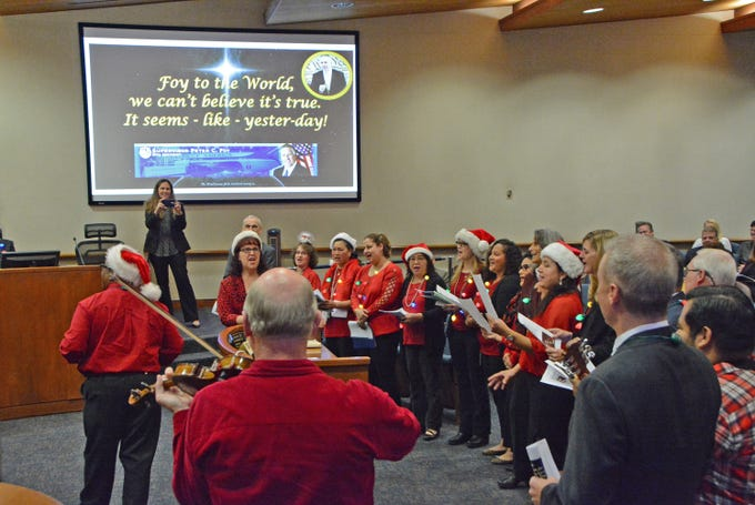 """The CountyChristmas Carolers sang an adaption of """"Joy to the World"""" renamed """"Foy to the World"""" to retiring Supervisor Peter Foy at Tuesday's board meeting."""