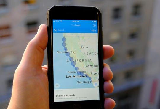 The new YourCoast app is displayed on a smartphone Thursday. The new smartphone app shows users a map of more than 1,500 access points along the California coast.