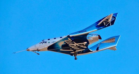 Virgin Galactic's VSS Unity is shown on a test flight over the California desert.