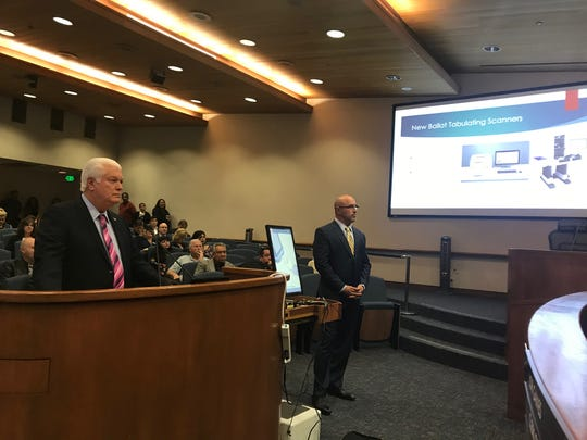 Registrar of Voters Mark Lunn and sales manager Steven Bennett appear before the Board of Supervisors to explain new voting system.