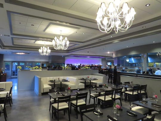 U-shaped booths and Lucite chandeliers are part of the decor at Slate Bistro & Craft Bar, which opened Dec. 2 at the former home of Safire American Bistro in Camarillo. Currently open for dinner, the new restaurant will add lunch service next week.