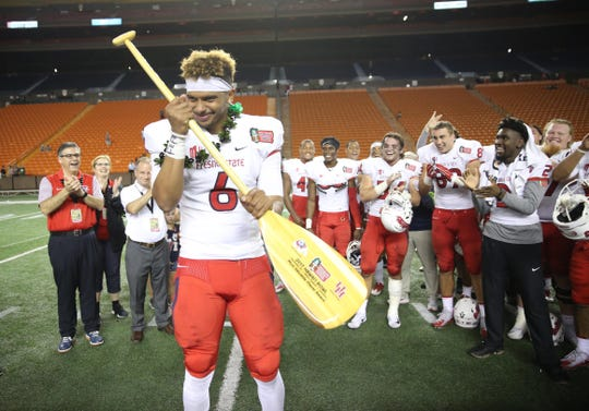Dec 24, 2017; Honolulu, HI, USA; Fresno State Bulldogs quarterback Marcus McMaryion (6) holds an MVP award after his team defeated the Houston Cougars 33-27 at the 2017 Hawaii Bowl at Aloha Stadium. Mandatory Credit: Marco Garcia-USA TODAY Sports