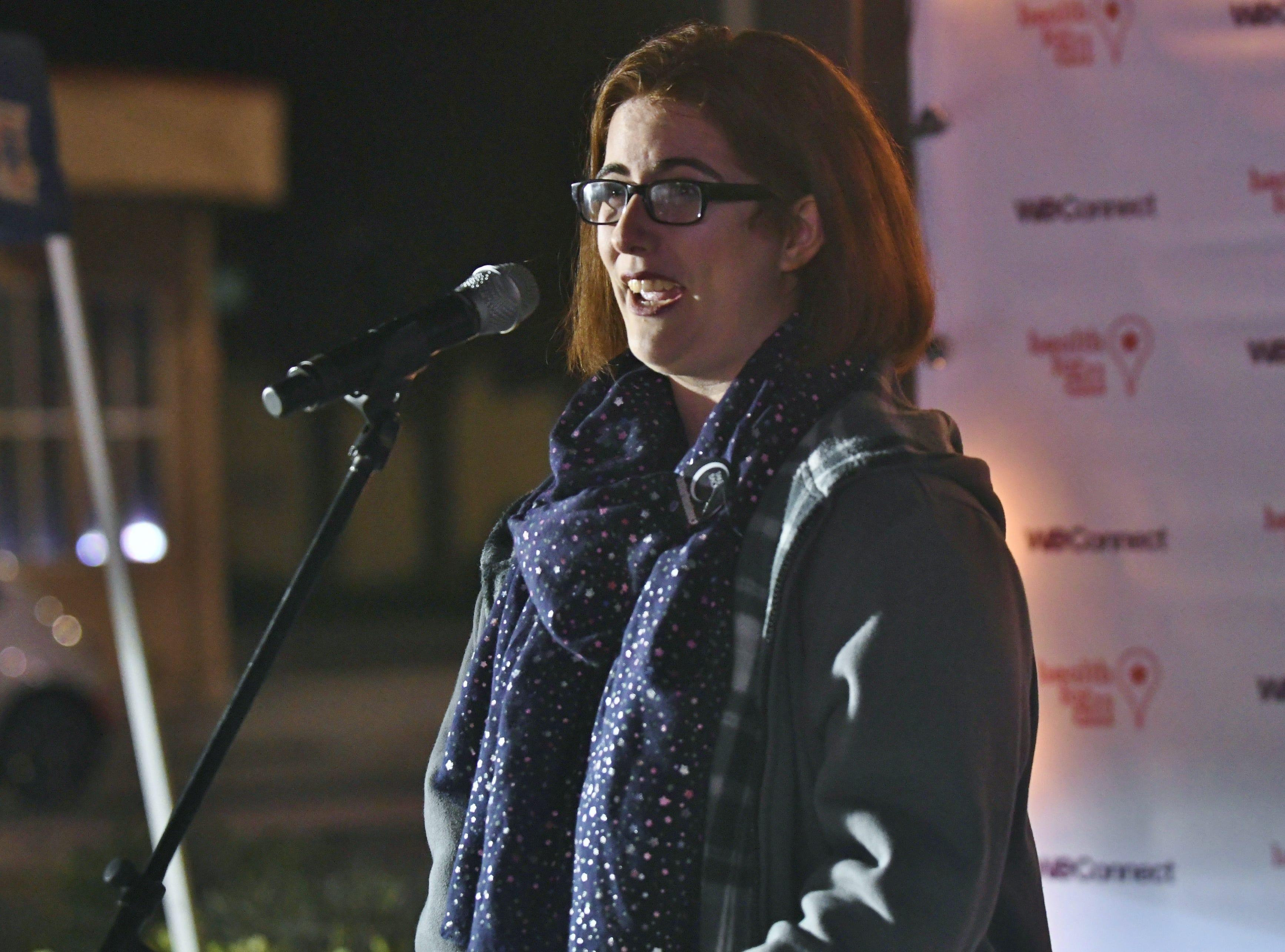 Brooke Mateus performed slam poetry during Visalia's Take Back the Night on Thursday.