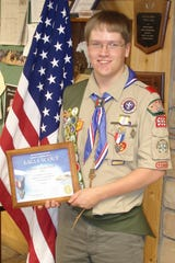 Matthew Pfantz, son of Gene and Sarah Pfantz of Merrill, is shown receiving his Eagle Scout badge in 2011. He graduated from Merrill High in 2013 and will lead the singing of the national anthem at the University of Wisconsin-Eau Claire commencement on Dec. 22, 2018.