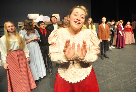 "Sarah Beck, center front, portrays the title role in Wausau West High School's production of ""Hello, Dolly"" in October 2013."