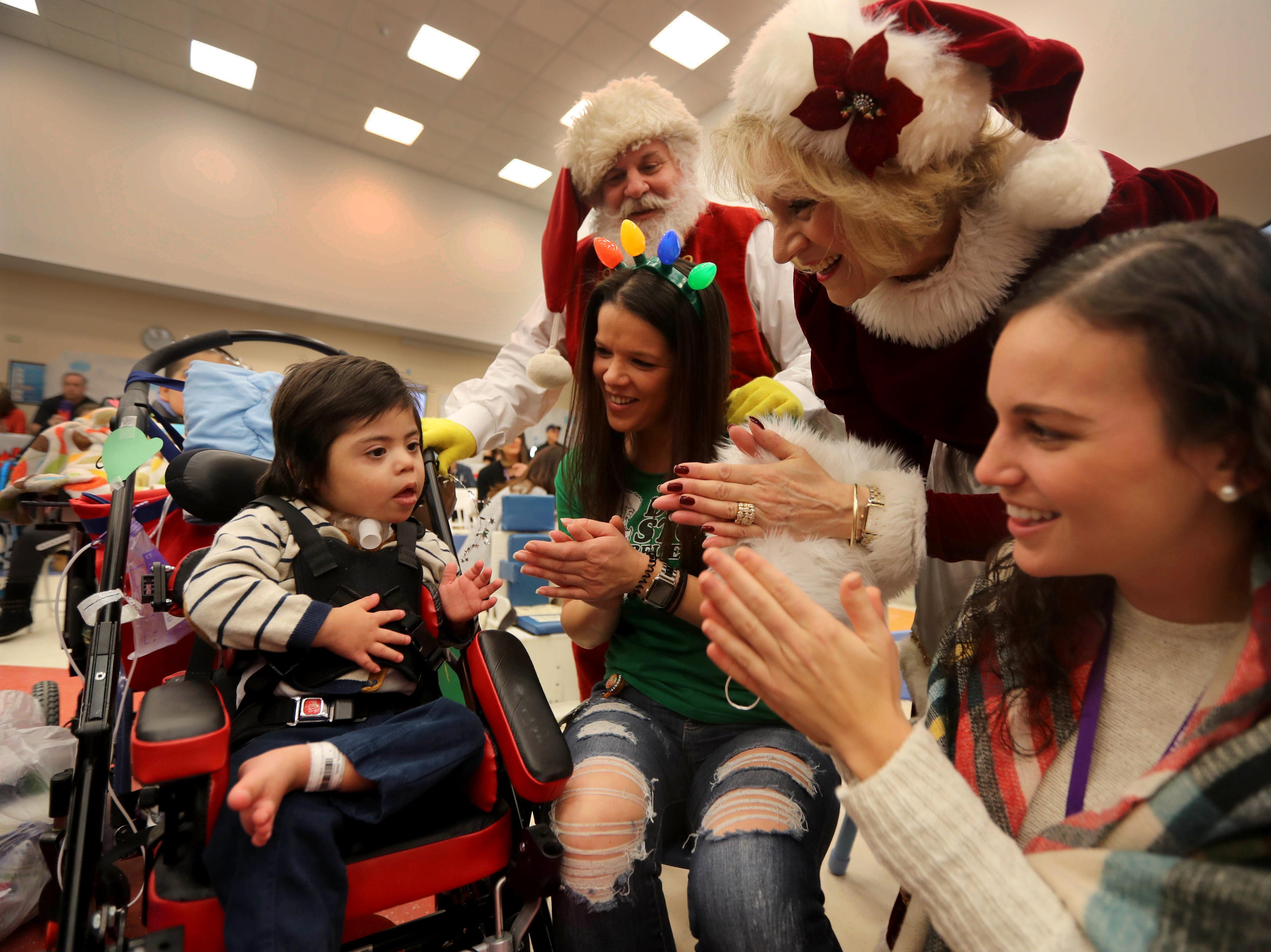 Paul Lopez, 3, a patient at Blythedale Children's Hospital in Valhalla, enjoys holiday music with speech therapists Jessica Catalano and Michelle Hesari, along with Santa and Mrs. Claus during the annual holiday show at the hospital Dec. 14, 2018. Scott Shannon, morning disc jockey with WCBS-FM hosts the show every year. This year's show included performances by Rob Thomas of Matchbox Twenty, Mark Rivera, who is Billy Joel's longtime saxophonist, and Grammy nominated singer and songwriter Gavin DeGraw. The event included a live auction that featured autographed guitars by Jon Bon Jovi and Rob Thomas and tickets to a Billy Joel concert at Madison Square Garden.