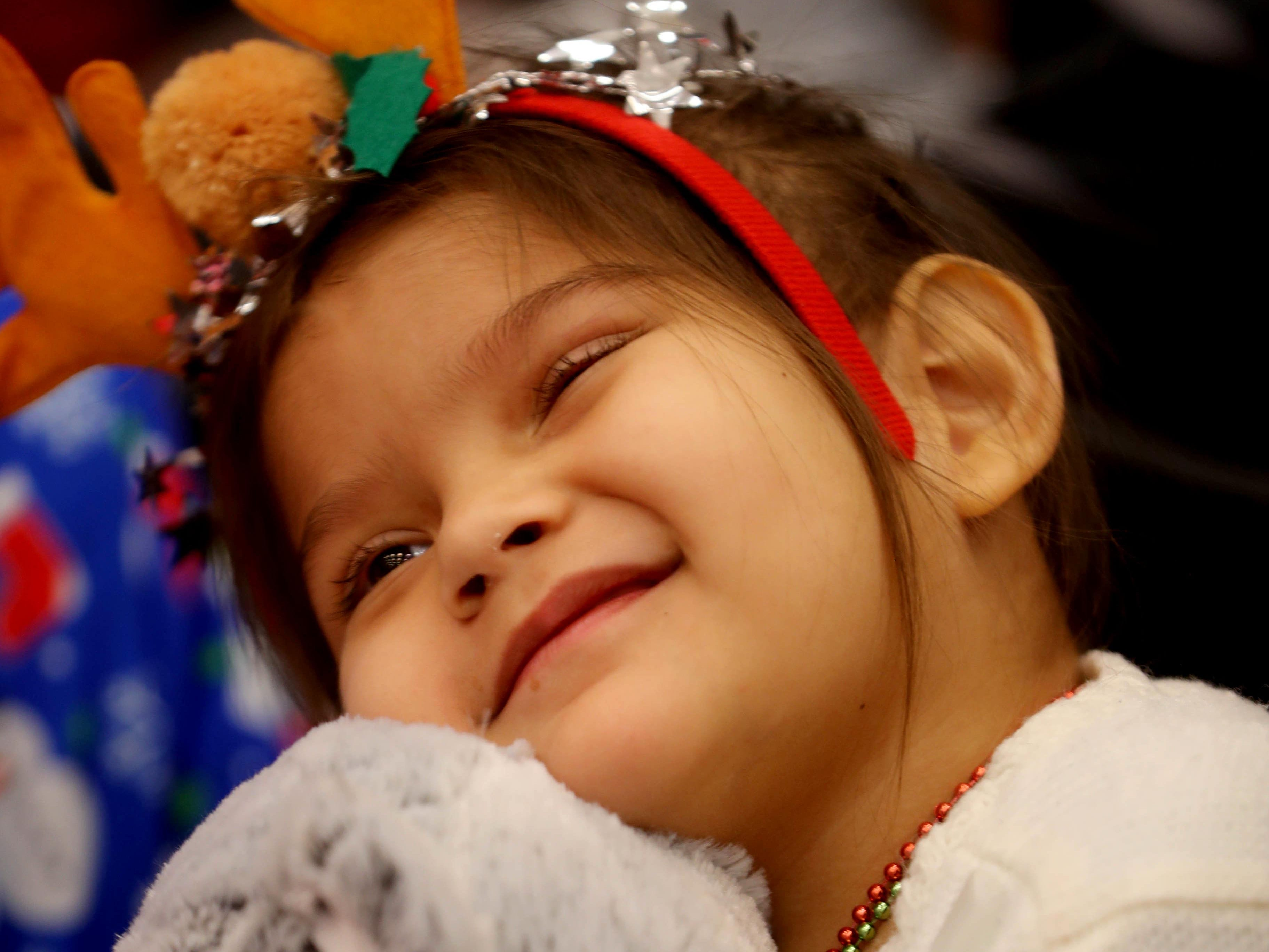 Daniela Hernandez, 5, a patient at Blythedale Children's Hospital in Valhalla, cuddles with a stuffed bear as she enjoys holiday music during the annual holiday show at the hospital Dec. 14, 2018. Scott Shannon, morning disc jockey with WCBS-FM hosts the show every year. This year's show included performances by Rob Thomas of Matchbox Twenty, Mark Rivera, who is Billy Joel's longtime saxophonist, and Grammy nominated singer and songwriter Gavin DeGraw. The event included a live auction that featured autographed guitars by Jon Bon Jovi and Rob Thomas and tickets to a Billy Joel concert at Madison Square Garden.